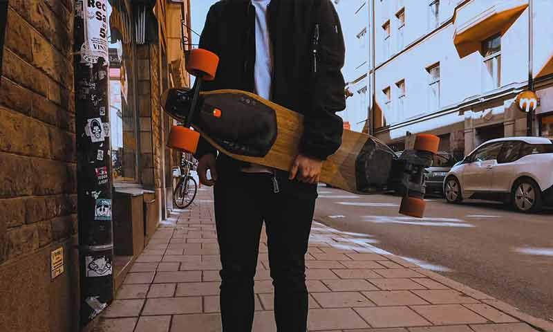 a man hold a mini-board